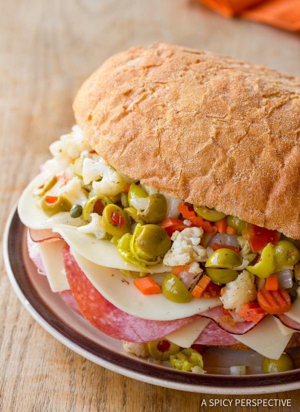 Muffuletta #ASpicyPerspective #NewOrleans #Sandwich #Muffuletta #MuffulettaSandwich #MuffulettaRecipe #OliveSalad