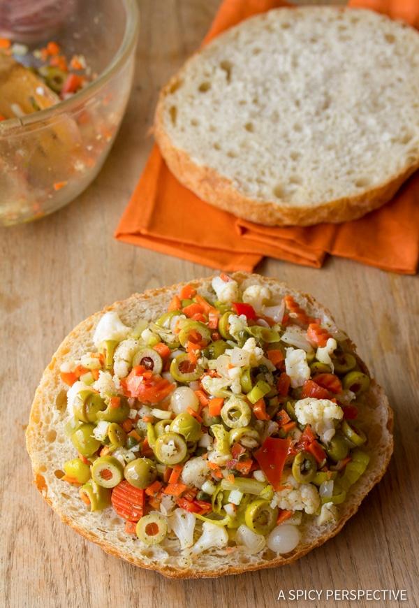 Muffuletta Sandwich Recipe #ASpicyPerspective #NewOrleans #Sandwich #Muffuletta #MuffulettaSandwich #MuffulettaRecipe #OliveSalad