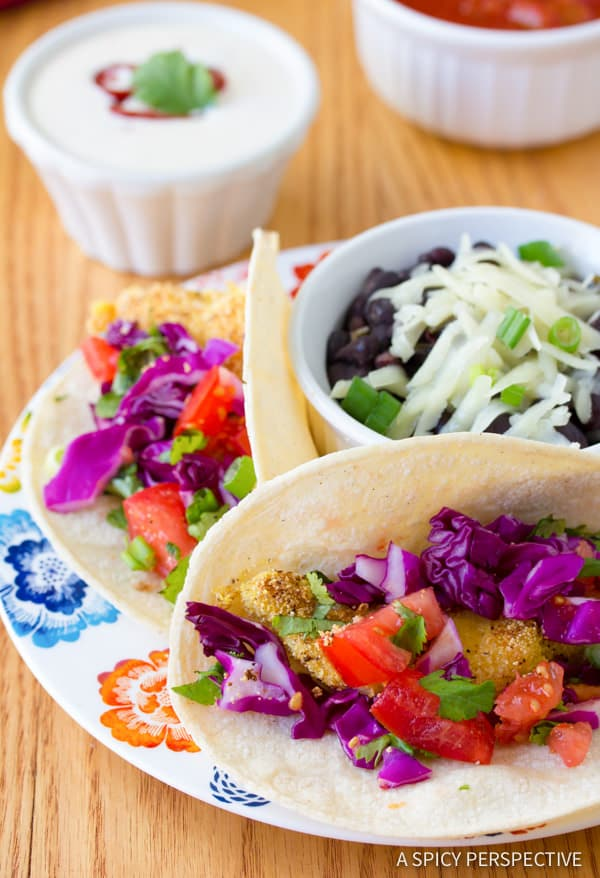 Crispy Corn Crusted Fish Tacos with Jalapeno Lime Sauce | ASpicyPerspective.com