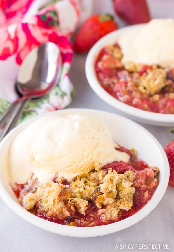 This bright blushing Fresh Strawberry Pistachio Crumble is the perfect summertime treat! It's an easy cobbler variation with a irresistible crumb topping!