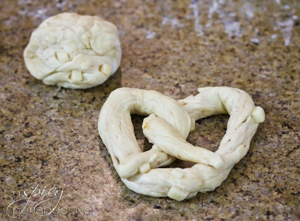 How to Twist a Soft Pretzel | ASpicyPerspective.com #SoftPretzels #CaramelApples #FallRecipes