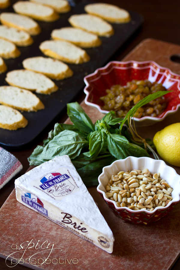 Easy Brie Toasts with Basil, Pine Nuts and Golden Raisins | ASpicyPerspective.com