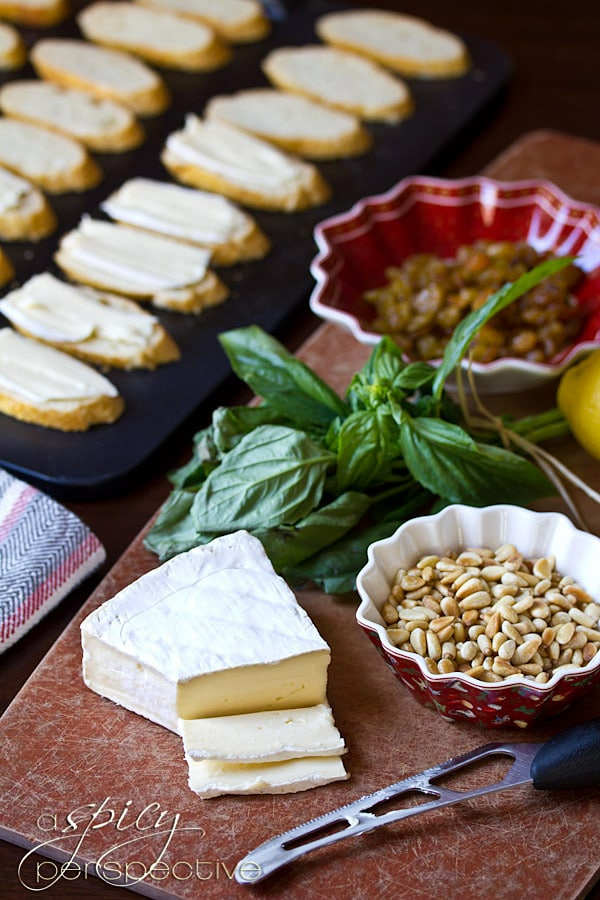 Brie Toasts with Basil Pine Nuts and Golden Raisins