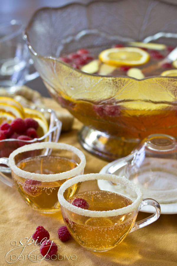 Champagne Punch with Raspberry and Orange Liqueur | ASpicyPerspective.com #cocktails #newyearseve #holidays