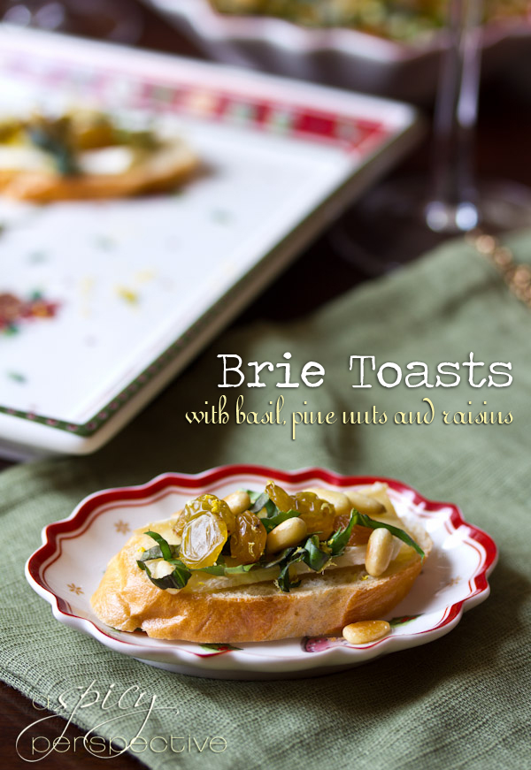Brie Toasts with Basil, Pine Nuts and Golden Raisins | ASpicyPerspective.com
