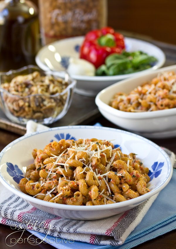 Roasted Red Pepper Pesto Pasta Recipe | ASpicyPerspective.com #pasta #healthy #wholegrain #DeLallo