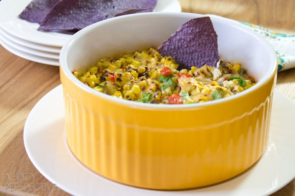 Chunky Fire Roasted Corn Dip | ASpicyPerspective.com #dip #party #florida #corn Pin & Win Contest Here: http://www.sunshinesweetcorn.com/home/livin-the-sweet-life-pinterest-contest/
