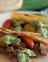 Sweet Pulled Pork Tacos with Avocado Cream on ASpicyPerspective.com from Gaby Dalkin #avocados #tacos