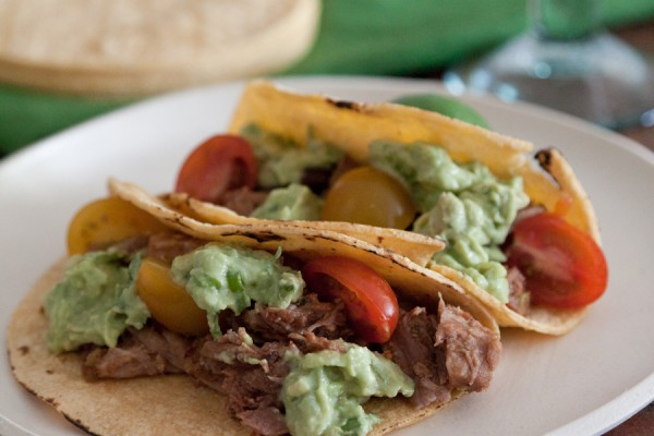 Sweet Pulled Pork Tacos with Avocado Crema on ASpicyPerspective.com from Gaby Dalkin #avocados #tacos