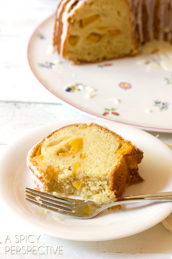 (Peach Cake) Amazing Peaches n' Cream Cake on ASpicyPerspective.com #cake #peach #bundtcake #summer #recipe
