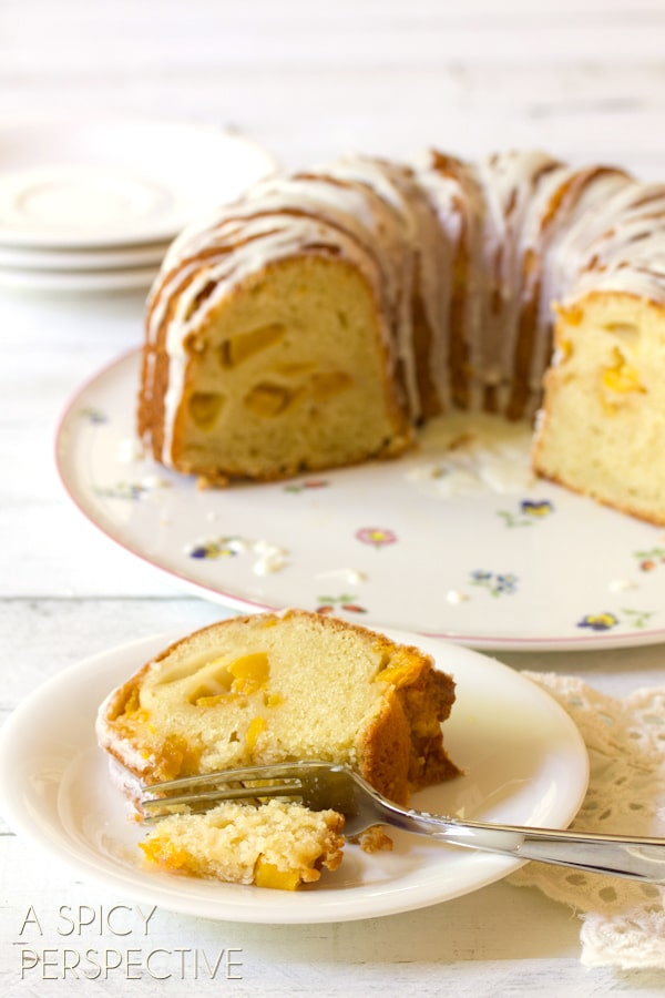 Must-Make Peaches n' Cream Cake on ASpicyPerspective.com #cake #peach #bundtcake #summer #recipe