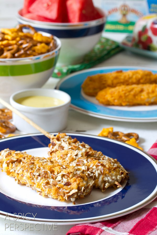 Cheesy Pretzel Chicken Pops with Honey Mustard Dip   ASpicyPerspective.com #kidfriendly #chickentenders #backtoschool #recipe