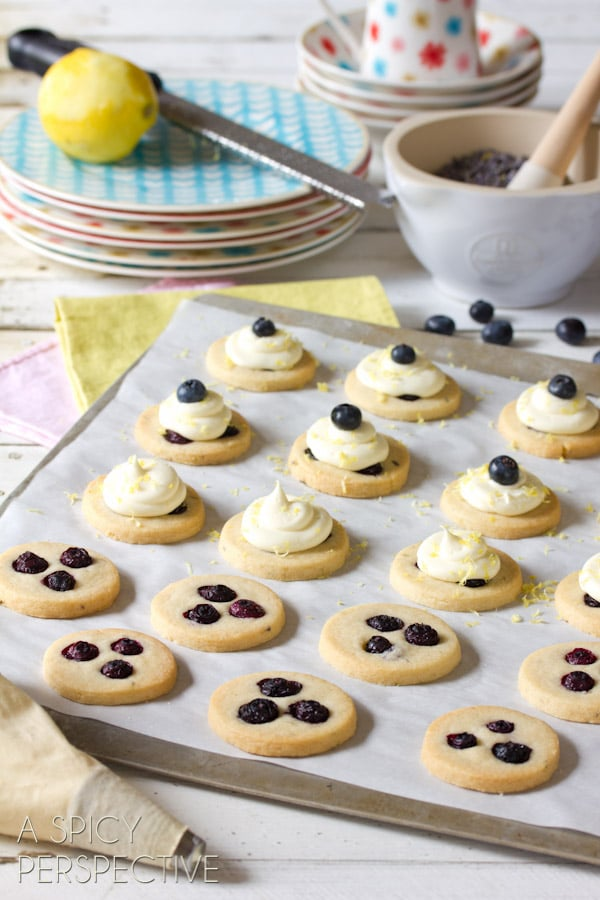 Cute Blueberry Shortbread Cookies with Lemon Frosting   ASpicyPerspective.com #cookies #shortbread #blueberries #babyshower