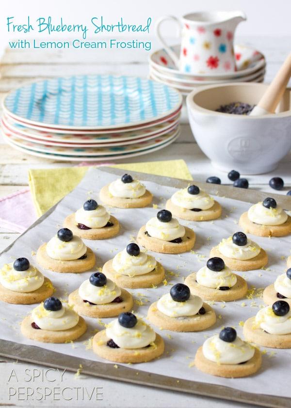 Fresh Blueberry Shortbread Cookies with Lemon Frosting   ASpicyPerspective.com #cookies #shortbread #blueberries #babyshower
