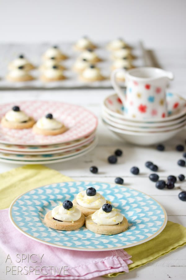 Blueberry Shortbread Cookies with Lemon Frosting | ASpicyPerspective.com #cookies #shortbread #blueberries #babyshower