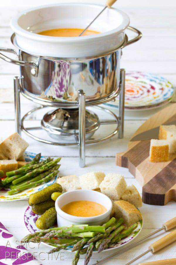 Pesto & Cheese Fondue Recipe | ASpicyPerspective.com #fondue #cheese #pesto #delallo