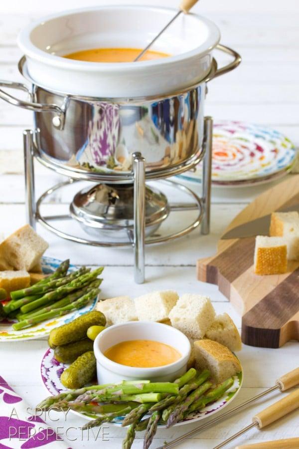 Pesto & Cheese Fondue Recipe | ASpicyPerspective.com #fondue #cheese #pesto #delallo