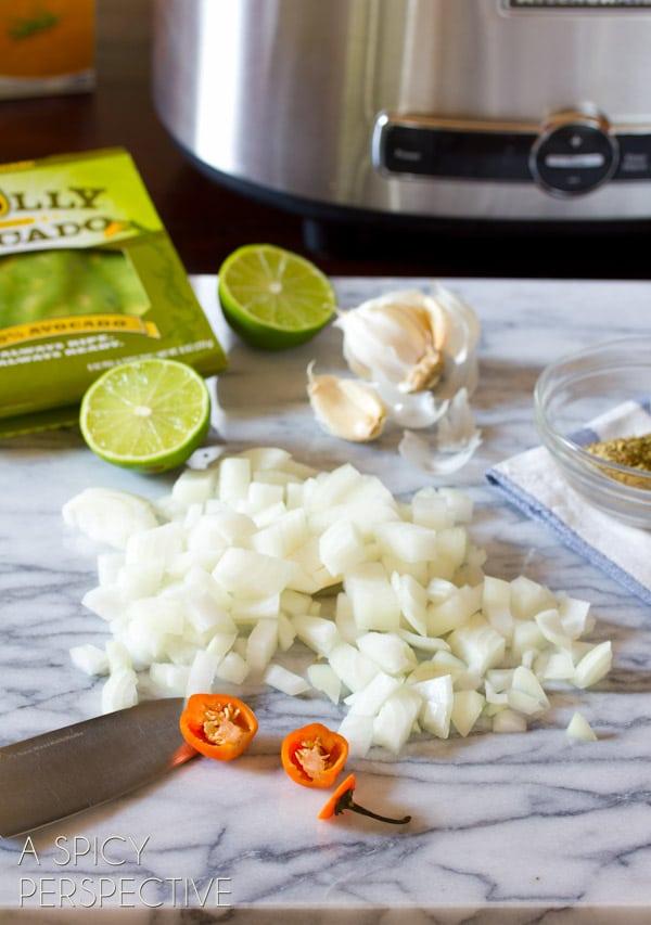Making Slow Cooker Guacamole Soup Recipe   ASpicyPerspective.com #soup #fall #gameday #avocado #slowcooker