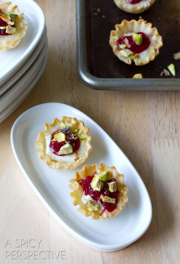 Cranberry Brie Bites Recipe #ASpicyPersepctive #cranberrybriebites #briebites #bakedbriebites #puffpastry