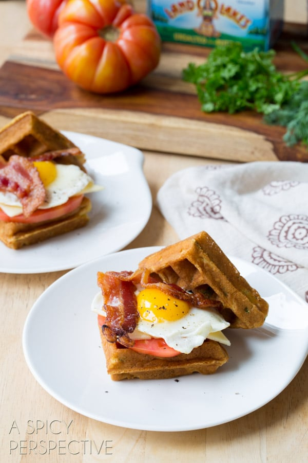 Amazing Waffle Sandwich made with Crispy Cornmeal Waffles, Bacon, Eggs, Cheese, and Heirloom Tomatoes! #breakfast #waffles #bacon