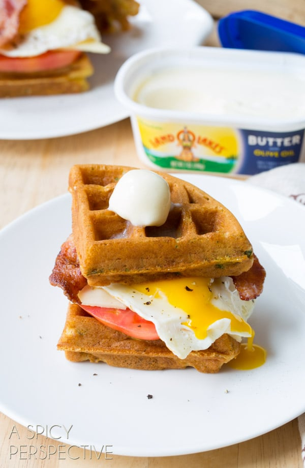 Easy Waffle Sandwich made with Crispy Cornmeal Waffles, Bacon, Eggs, Cheese, and Heirloom Tomatoes! #breakfast #waffles #bacon