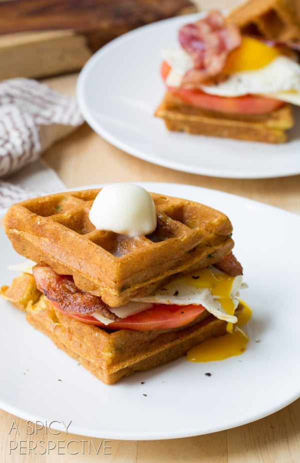 Savory Waffle Sandwich made with Crispy Cornmeal Waffles, Bacon, Eggs, Cheese, and Heirloom Tomatoes! #breakfast #waffles #bacon