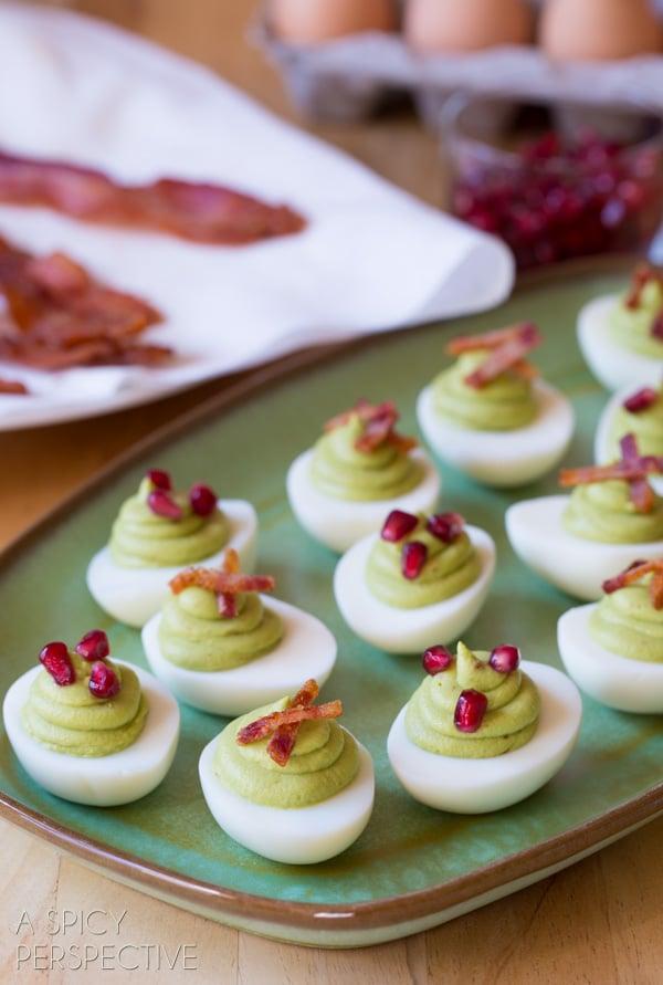Easy Avocado Deviled Eggs topped with #Bacon and #Pomegranate! #deviledeggs #easter #avocado