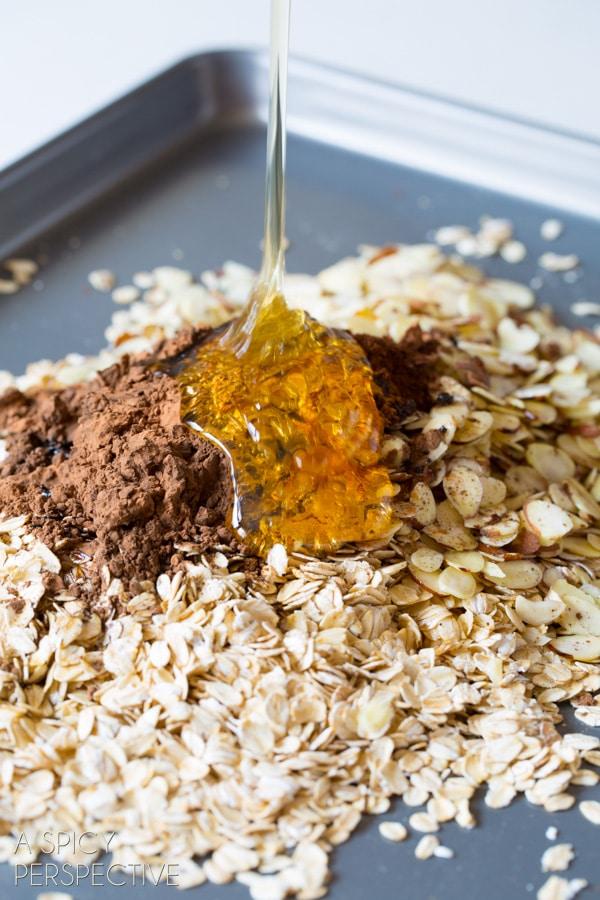 Making - Almond Joy Homemade Granola Recipe on ASpicyPerspective.com #recipe #granola #almondjoy #chocolate