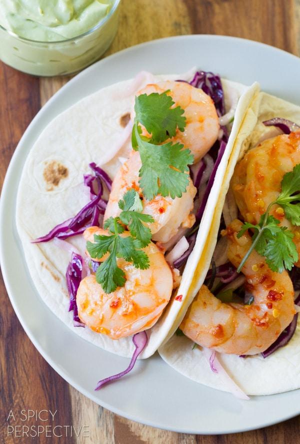 Thai Sweet Chile Shrimp Tacos with Jicama Slaw and Avocado Cream! #thai #tacos #spring #summer