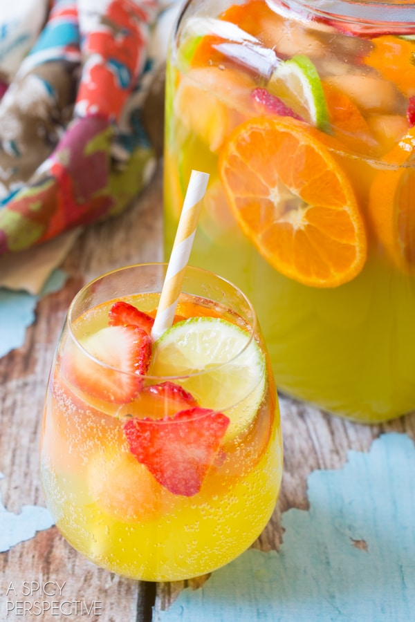 Amazing White Sangria with Melon, Ginger Liqueur and Berries! #sangria #summer #cocktails #party