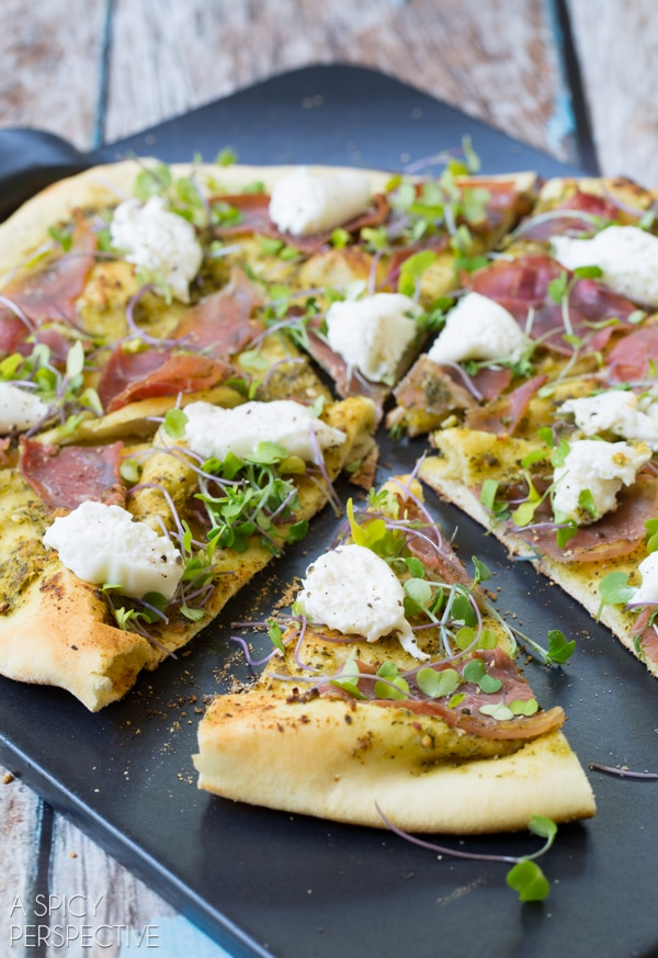 Pesto Pizza with burrata, prosciutto, and micorgreens #pizza #grilled #italian