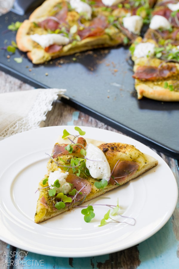 Simple Grilled Pesto Pizza with burrata, prosciutto, and micorgreens #pizza #grilled #italian