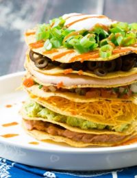 Seven Layer Dip Tostada Stack