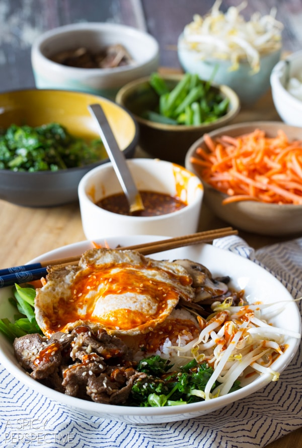 Korean Bibimbap - Rice and Veggie Bowl with a Fried Egg and Gochujang Sauce #beef #healthy #Korean