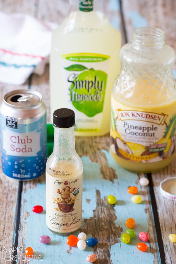 Easy Preggy Punch Mocktail - Pineapple Coconut, Lime and Ginger Juice garnished with Jelly Beans and Cotton Candy!! #babyshower #kids #party #punch