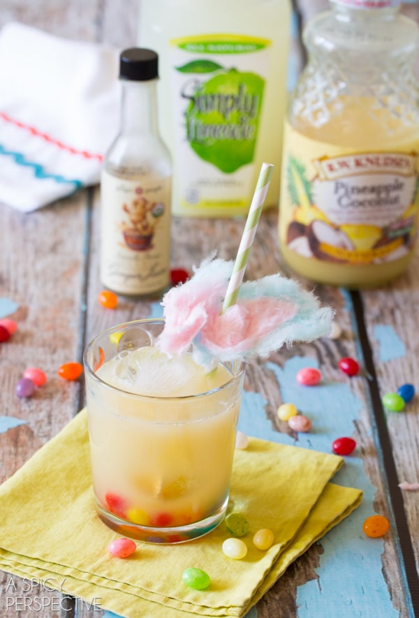Pretty Preggy Punch Mocktail - Pineapple Coconut, Lime and Ginger Juice garnished with Jelly Beans and Cotton Candy!! #babyshower #kids #party #punch