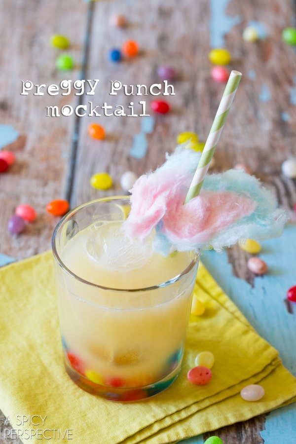Preggy Punch Mocktail - Pineapple Coconut, Lime and Ginger Juice garnished with Jelly Beans and Cotton Candy!! #babyshower #kids #party #punch