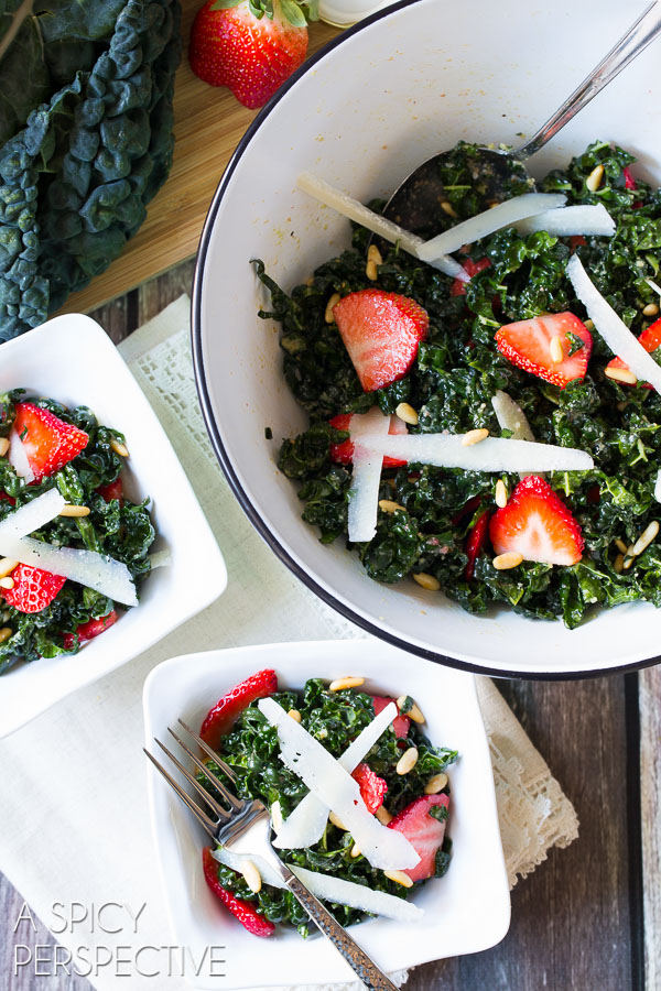 A slightly wilted kale salad recipe kissed with a honey-lemon dressing, and tossed with crunchy pine nut, nutty pecorino cheese, and bright blushing strawberries!