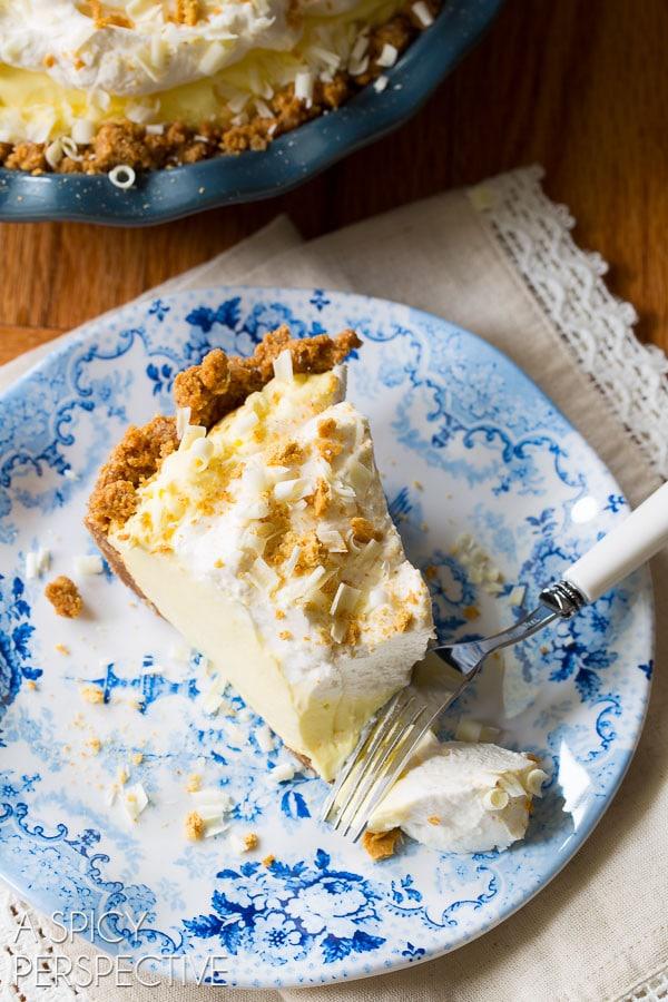 Our Favorite Lemon Cream Pie Recipe with Graham Cracker Crust on ASpicyPerspective.com #pie #spring #easter