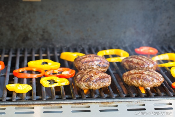 Grilling LAMB BURGERS with Tabbouleh and Grilled Peppers on ASpicyPerspective.com #burgers #lamb