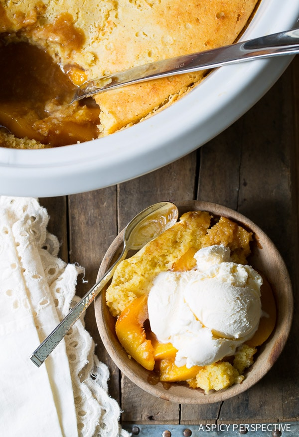 Best Ever Slow Cooker Peach Cobbler on ASpicyPerspective.com #slowcooker #crockpot #cobbler