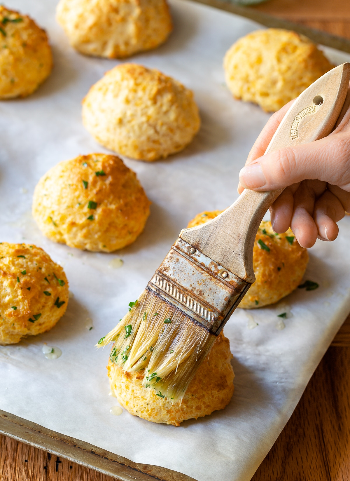 butter and parsley topped cheddar cheese biscuits #aspicyperspective