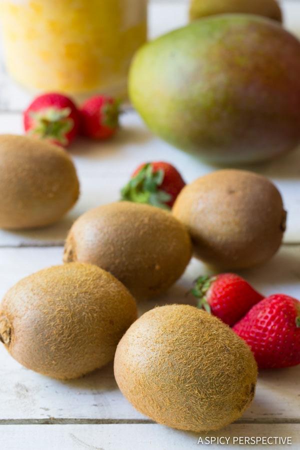 Making Tropical Fruit Salad in Kiwi Cups on ASpicyPerspective.com #fruitsalad #kiwi