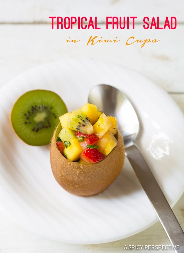 Amazing Tropical Fruit Salad in Kiwi Cups on ASpicyPerspective.com #fruitsalad #kiwi