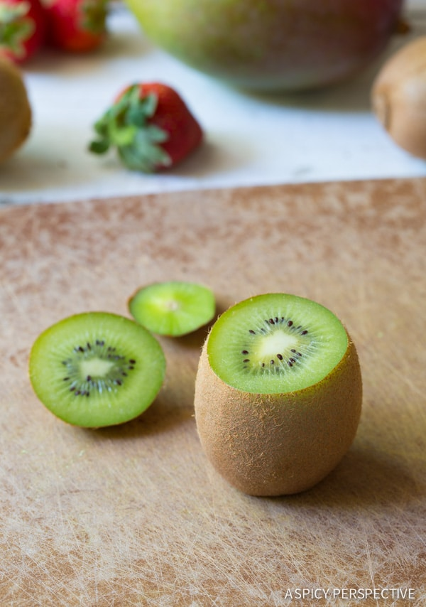 Step 2 - Tropical Fruit Salad in Kiwi Cups on ASpicyPerspective.com #fruitsalad #kiwi