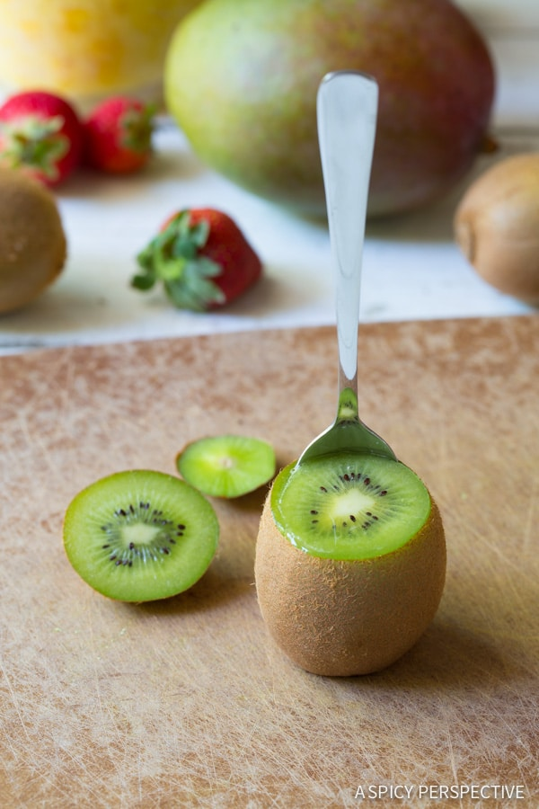 Step 3 - Tropical Fruit Salad in Kiwi Cups on ASpicyPerspective.com #fruitsalad #kiwi