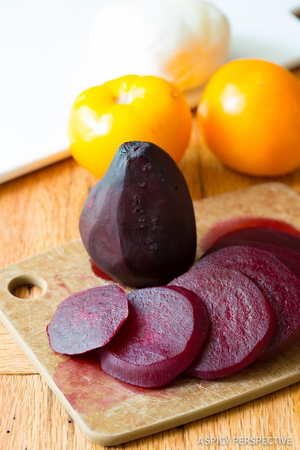 How to Make Caprese Salad Recipe with Roasted Beets and Garlic Vinaigrette on ASpicyPerspective.com #salad #caprese
