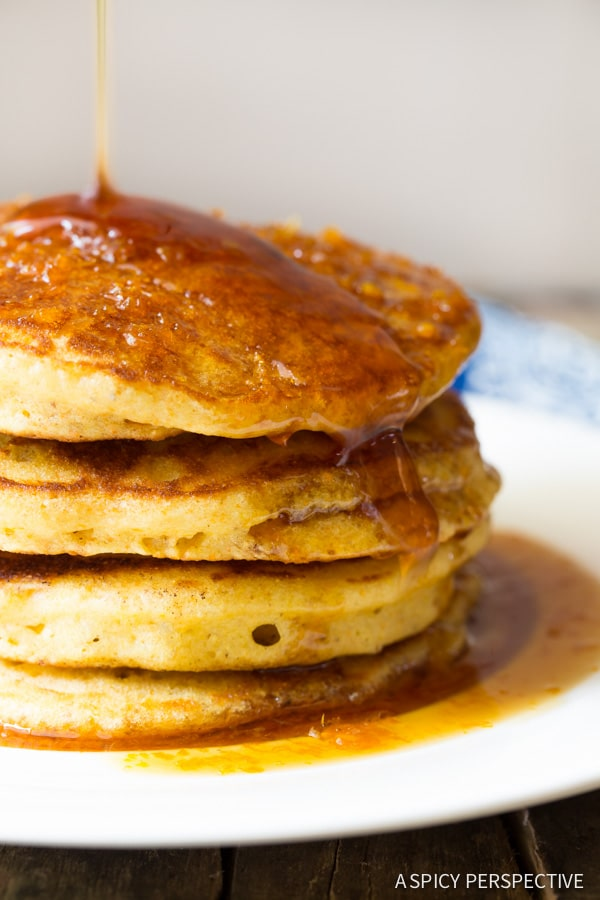 Tender Cornmeal Pancakes with Orange Syrup on ASpicyPerspective.com #breakfast #pancakes
