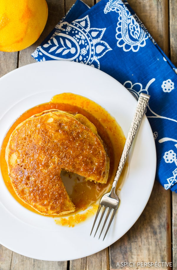 Crazy-Good Cornmeal Pancakes with Orange Syrup on ASpicyPerspective.com #breakfast #pancakes