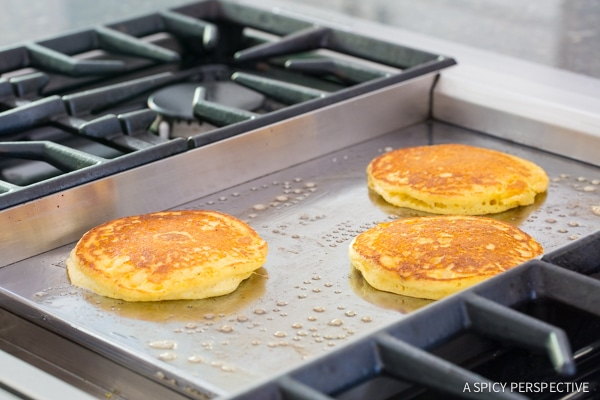 Hot Cornmeal Pancakes with Orange Syrup on ASpicyPerspective.com #breakfast #pancakes
